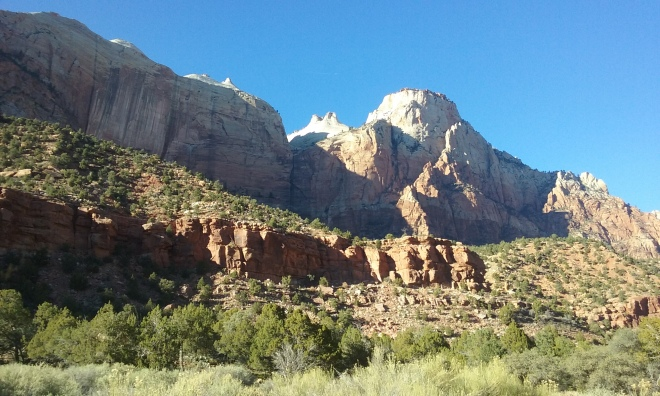 I love taking a walk through Zion and seeing these types of rock formations everywhere. Sometimes, if you look close enough, you can see rock climbers scaling their walls. (I didn't see any on this one, however.)