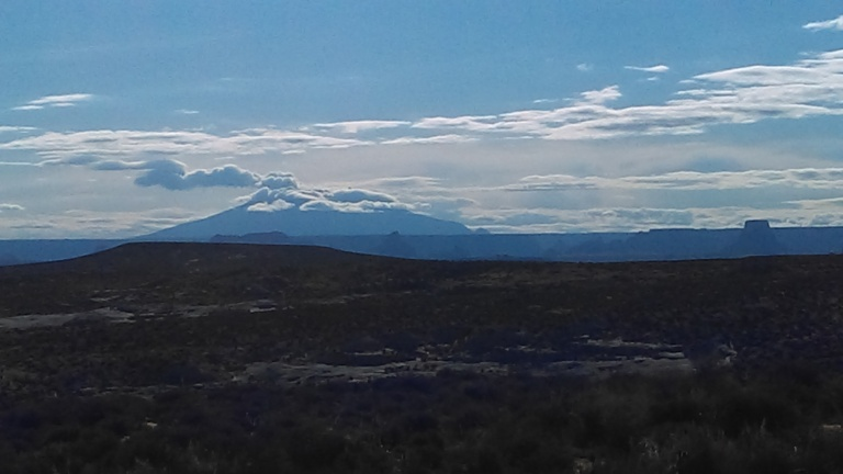 Navajo Mountain off in the distance. I see this every day from my neighborhood and on my way to work. A very sacred place for the Navajo Nation.